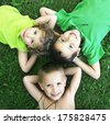 some kids playing in the grass together - stock photo