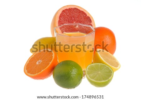Some kind of citrus with the glass filled with citrus juice on white background isolated - stock photo