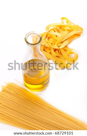 Some kinds of a spaghetti and olive oil bottle on a white background - stock photo