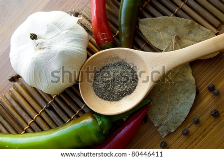 Some kinds of pepper, onion on wooden plate