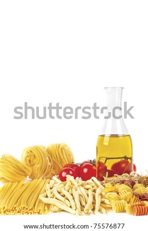 Some kinds of the Italian pasta, bottle of olive oil and tomatoes on a white background. A shot horizontal, focus in the shot center. - stock photo