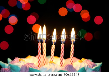 Some lit birthday candles close up - stock photo