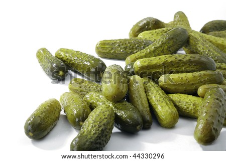Some marinated cucumbers isolated on the white background - stock photo