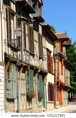 Some medieval half-timbered houses in a row in the old town of Troyes, Aube, Champagne-Ardenne, France. - stock photo