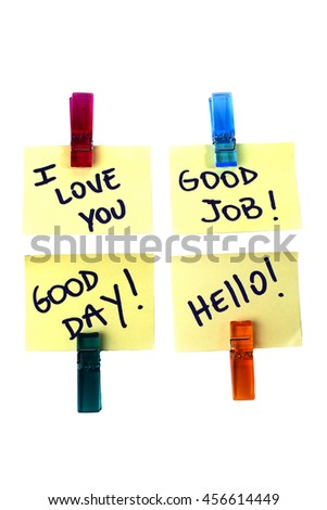 Some messages written on a yellow paper note with a clothespins holding isolated over a white background - stock photo