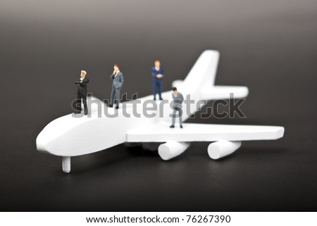 some minaiture people on plane - stock photo