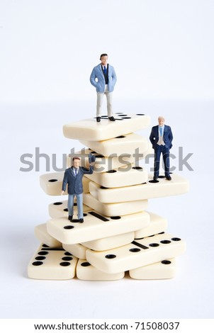 some miniature people on domino cubes - stock photo