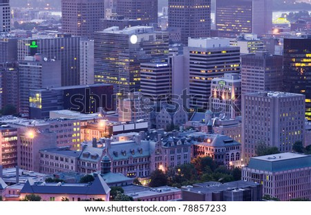 Some Montreal Office Buildings and Urban Development, view of the Mountain of Mont-Royal at Dusk - stock photo
