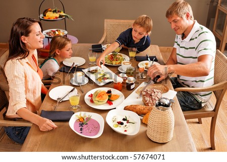 some more bread please - family having breakfast - stock photo