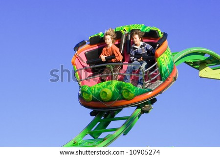 SOME MOTION BLUR DUE TO FAST SPEED. fun at the fun fair - stock photo