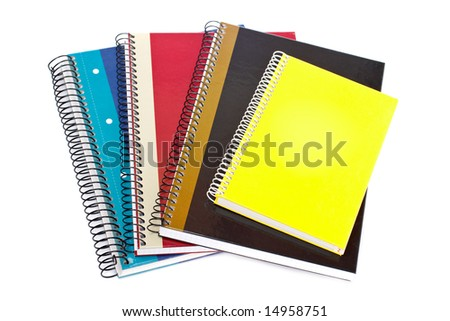 Some notebooks isolated on white background. Shallow depth of field - stock photo