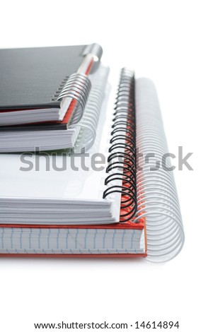 Some notebooks with soft shadow on white background. Shallow DOF - stock photo