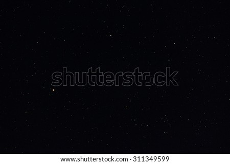 Some of the stars within the Orion constellation as seen by a 200mm lens - stock photo