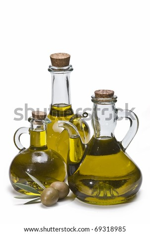 Some oil jugs with some olives isolated on a white background.
