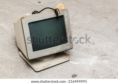 some old and obsolete pc and keyboards dumped in the street - stock photo