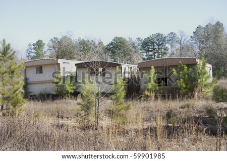 Some old mobile home trailer houses in the horizontal format with copy space. - stock photo