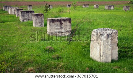 Some old pile buried in the ground - stock photo
