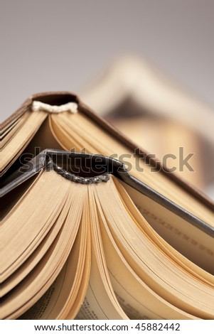 Some opened big books - stock photo