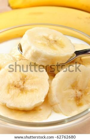 some organic banana slices  in natural yoghurt - stock photo