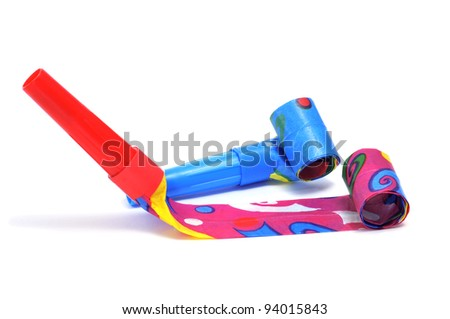 some party horns of different colors on a white background - stock photo