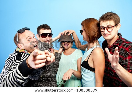 some people on blue background with fun - stock photo