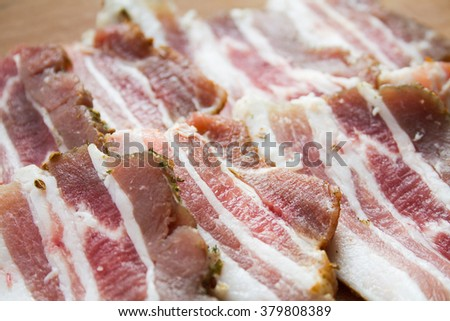 Some pieces of marinated bacon. Fresh marinated bacon with the spices. Ukrainian cuisine - marinated bacon.