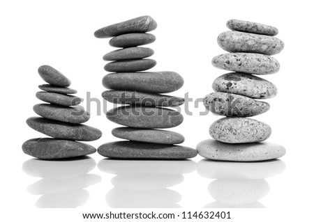 some piles of balanced stones on a white background - stock photo