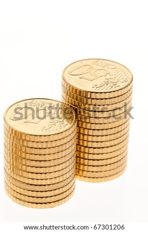 Some piles of coins on white background ? - stock photo