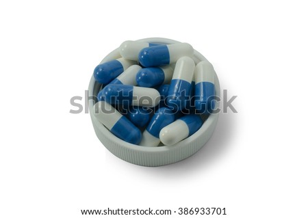 some pills of a white and blue colors with white cap on a white background