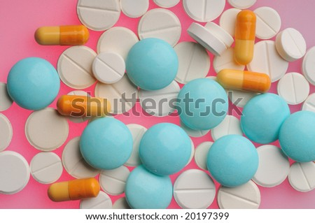 Some pills over color background