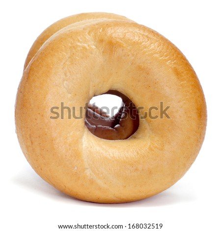 some plain bagels on a white background - stock photo