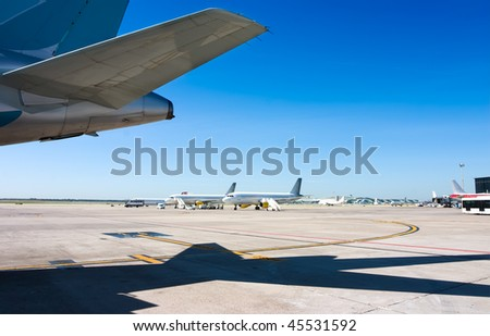 Some planes in an international airport - stock photo