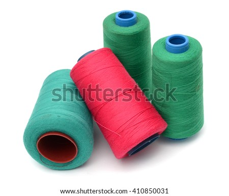 Some plastic spools with multicoloured threads isolated on white - stock photo