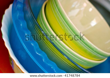 Some plates of the different form and color. Kitchen utensils - stock photo