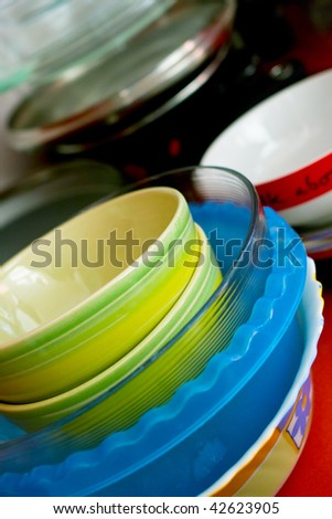 Some plates of the different form and color. Kitchen utensils. Shallow DOF