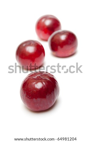 some plums isolate on white background