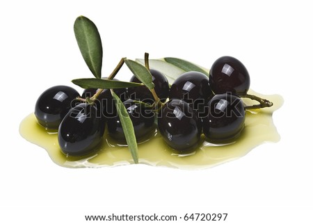 Some premium olives on olive oil isolated on a white background. - stock photo