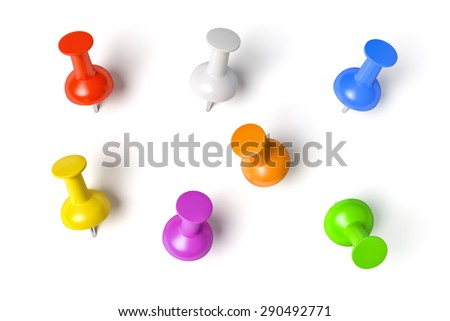 Some push pins in different colors isolated on a white background