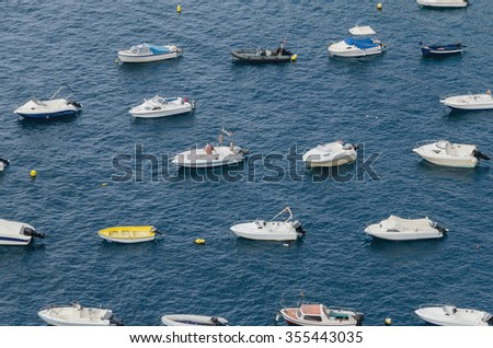Some recreative and fishing ships moored in the coast - stock photo