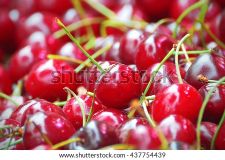 Some red cherries on a table, close up.