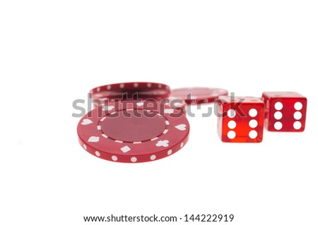 Some red chips and two dice showing six - stock photo