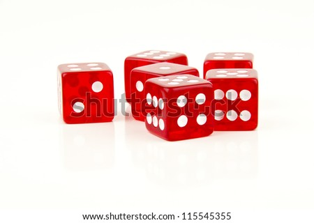 some red dice scattered on white background - stock photo