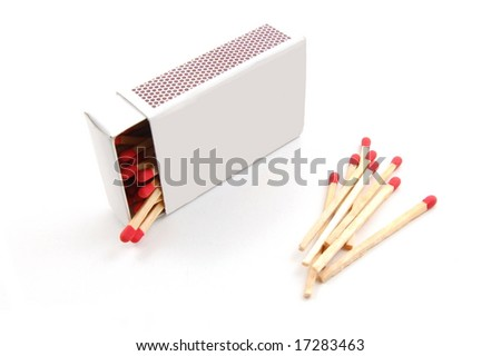 Some red matches isolated on a white background. - stock photo