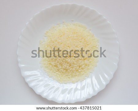 Some rice on a white plate.