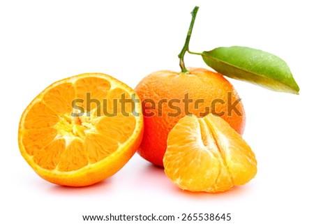 some ripe pieces orange mandarin on white background - stock photo