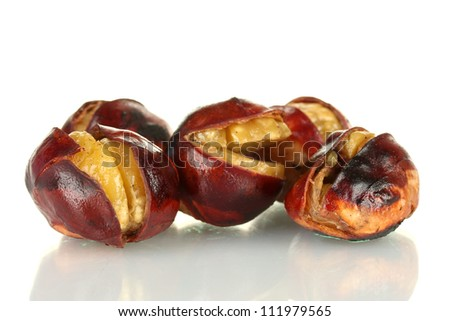 some roasted chestnuts isolated on white - stock photo