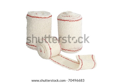 some rolls of bandage isolated over white. Medical treatment concept - stock photo