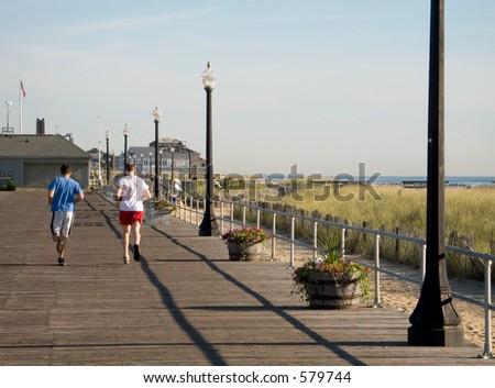 Some runners training on the boardwalk in Ocean Grove NJ. - stock photo