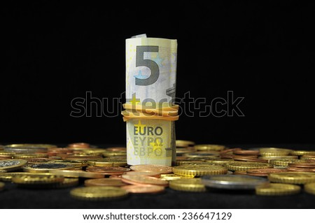 Some Scattered Money Representing Different Markets Financial Concept - stock photo