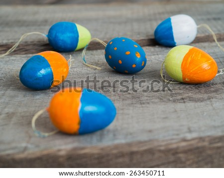 Some selfmade painted easter eggs on a wooden table - selective focus - stock photo